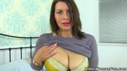 Milf doing a striptease before masturbating